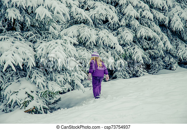 charming child in winter nature - csp73754937