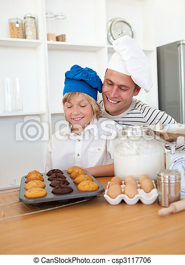 Charming father and his son presenting their muffins - csp3117706