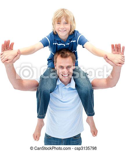 Charming father giving his son piggyback ride - csp3135798