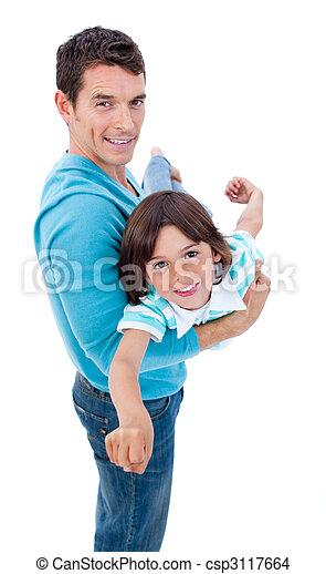 Charming father giving his son piggyback ride - csp3117664