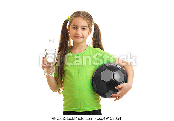 ae39ef2e1 Charming little girl in green uniform with soccer ball isolated on ...