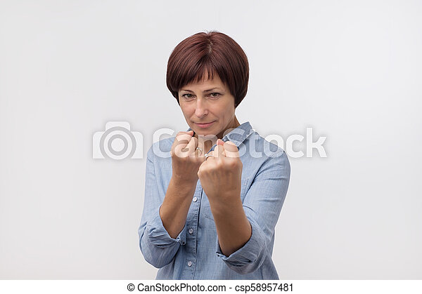 c610fa2d3ecf Charming Mature Caucasian Woman In Blue Shirt Raising Fists, Standing In  Boxer Pose.