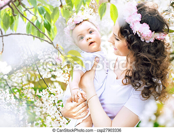 Charming mother walking in the orchard with a daughter - csp27903336