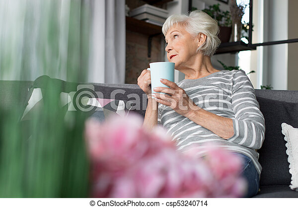 Charming Old Woman Relaxing On Couch With Hot Drink Pleasant