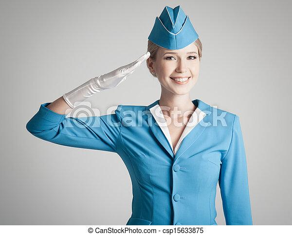 Charming Stewardess Dressed In Blue Uniform On Gray Background - csp15633875