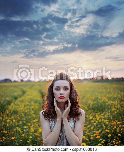 Charming woman among wild-flowers fields - csp31668016