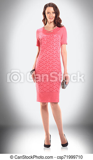 charming woman model in red knitted dress - csp71999710