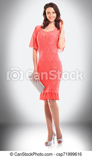 charming woman model in red stylish dress - csp71999616