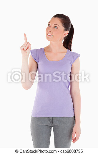Charming woman pointing at a copy space - csp6808735