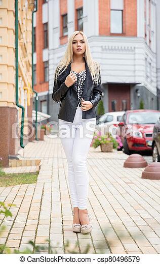 Charming woman posing on the street - csp80496579