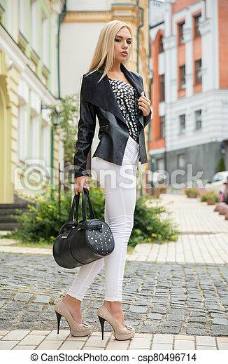 Charming woman posing on the street - csp80496714