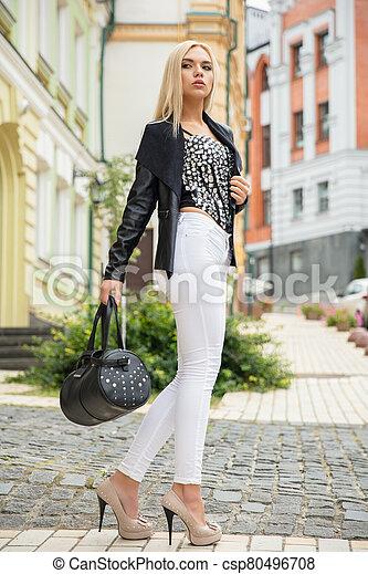 Charming woman posing on the street - csp80496708