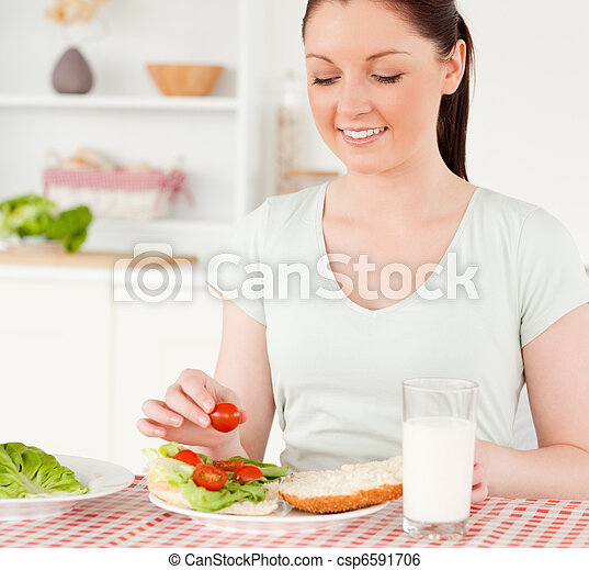 Charming woman ready to eat a sandwich for lunch - csp6591706