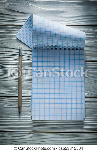 Checked notepad pencil on white wooden board - csp53315504