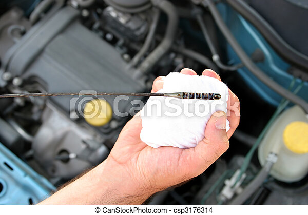 checking engine oil dipstick in car - csp3176314