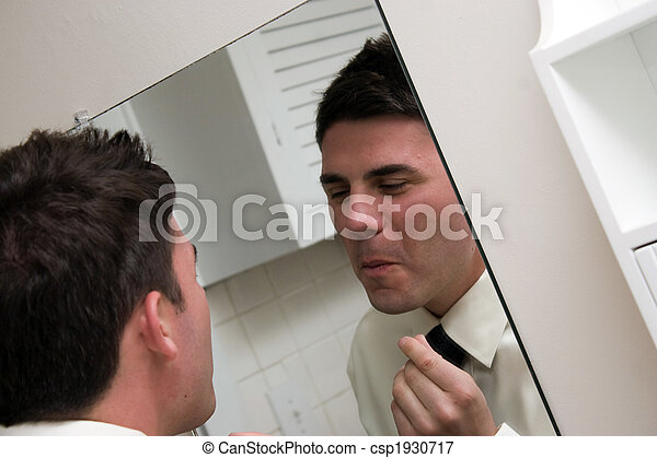 Checking Himself in the Mirror - csp1930717