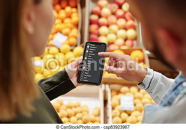 Checking list of products on smartphone - csp83923967