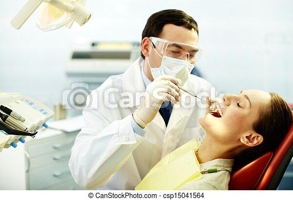 Checking up teeth - csp15041564
