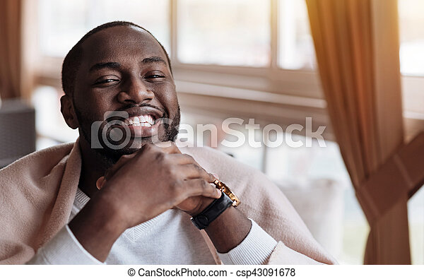 Cheerful African American man sitting in the cafe - csp43091678