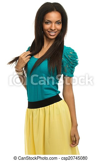 Cheerful african-american woman in summer dress - csp20745080