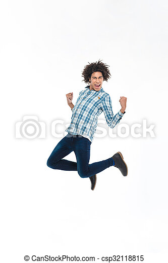 Cheerful afro american man jumping  - csp32118815