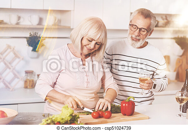 Cheerful aged couple cooking in the kitchen - csp51024739