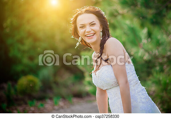 Cheerful bride showing happiness - csp37258330