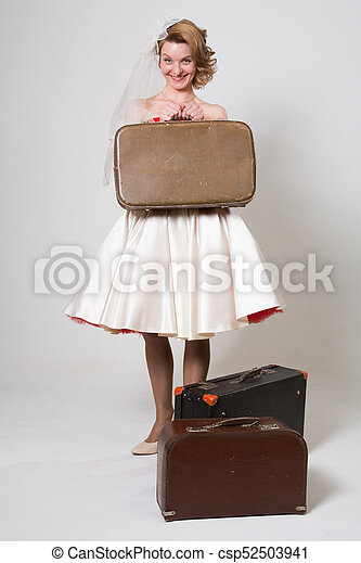 Cheerful bride with suitcases - csp52503941