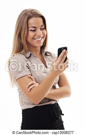 Cheerful businesswoman texting on mobile phone - csp13008377