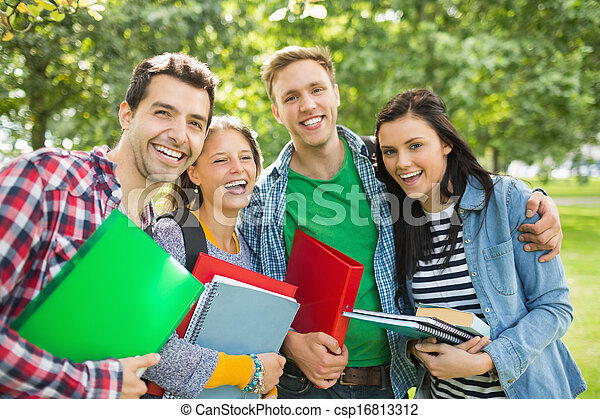 Cheerful College Students With Bags And Books In Park Stock Photo