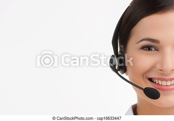 Cheerful customer service representative. Portrait of beautiful young female customer service representative in headset looking at camera and smiling while isolated on white - csp16633447