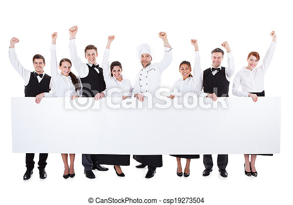 Cheerful excited catering staff showing banner - csp19273504