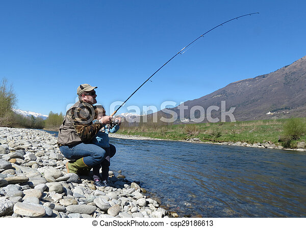 Cheerful father and daughter fishing together on the river - csp29186613