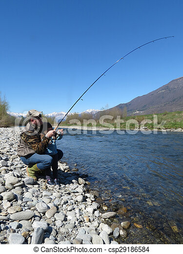 Cheerful father and daughter fishing together on the river - csp29186584