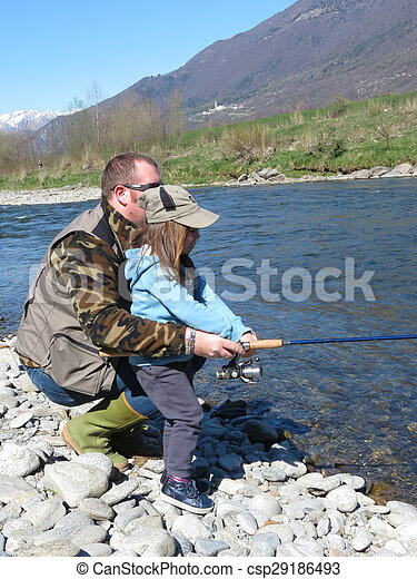 Cheerful father and daughter fishing together on the river - csp29186493