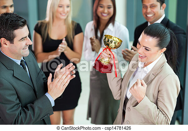 cheerful female corporate worker receiving a trophy - csp14781426