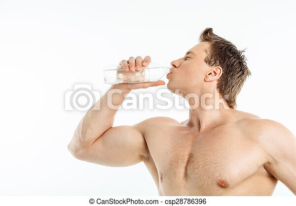 Cheerful healthy young man is very thirsty - csp28786396