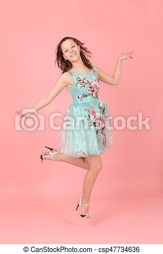 Cheerful jumping girl - csp47734636