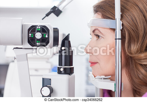 Cheerful lady is getting ophthalmology diopters calibration - csp34066262