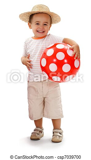 Cheerful little boy in straw hat, holding red dotted ball - csp7039700