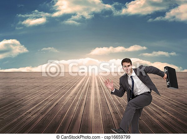 Cheerful man holding a suitcase and running - csp16659799