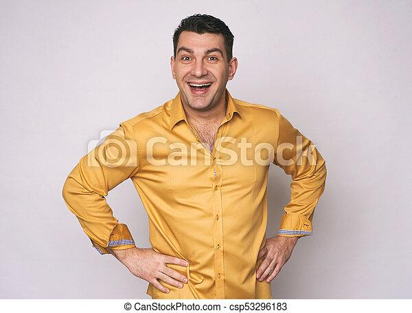 Cheerful man looking at camera. Isolated - csp53296183