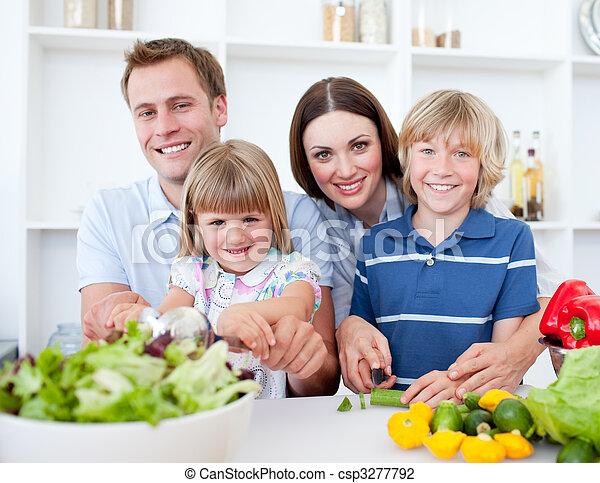 Cheerful parents preparing a dinner with their children in the kitchen - csp3277792