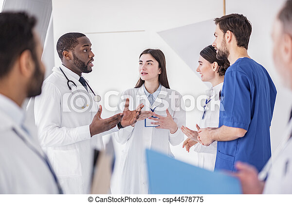 Cheerful physicians speaking at conference in clinic - csp44578775