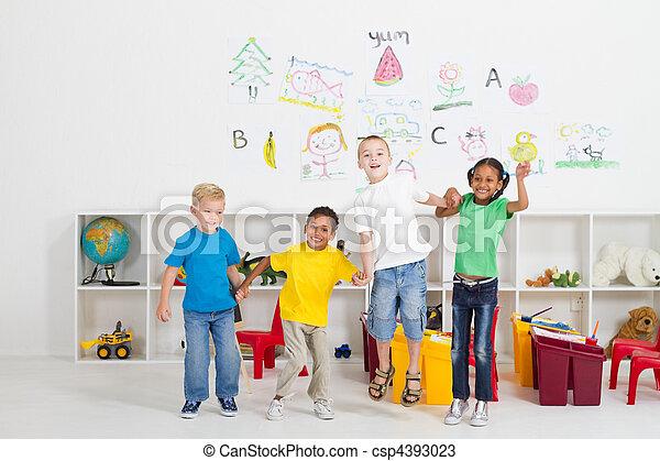 cheerful preschool kids jumping  - csp4393023
