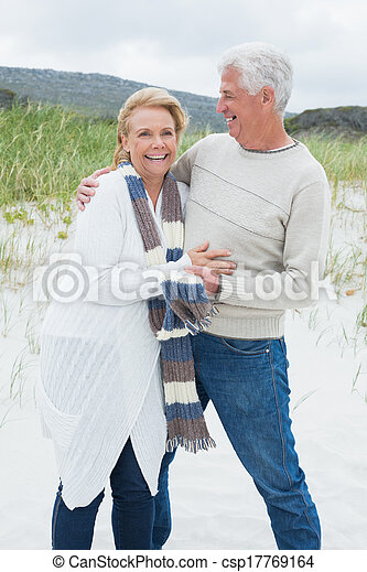 Cheerful romantic senior couple at beach - csp17769164