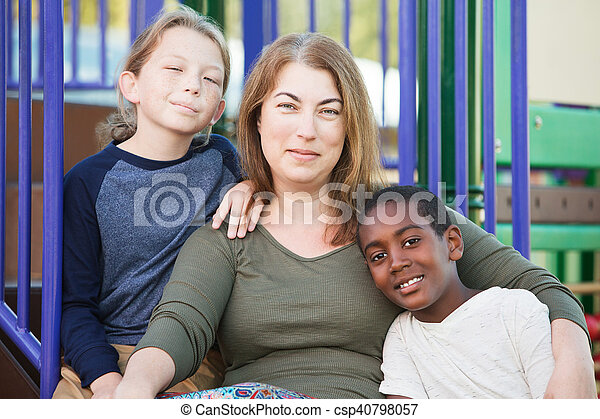 Cheerful single mom with sons outside - csp40798057