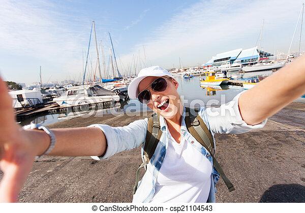cheerful tourist taking selfie by wharf - csp21104543
