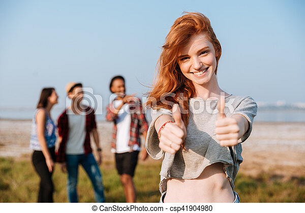 Outdoor redhead thumbs