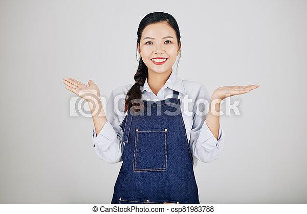 Cheerful woman shrugging shoulders - csp81983788